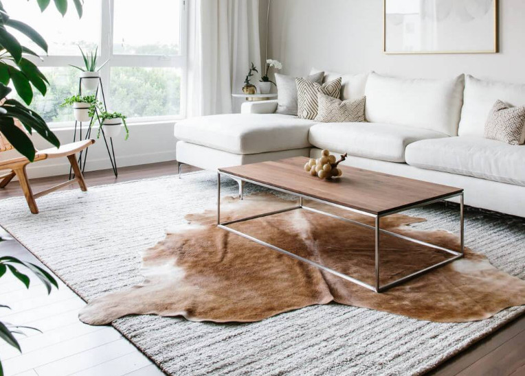 Layered Cowhide Rug and 4 Ideas to Layer Your Old Rugs